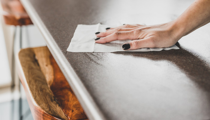 Sanitize kitchen and bathroom surfaces